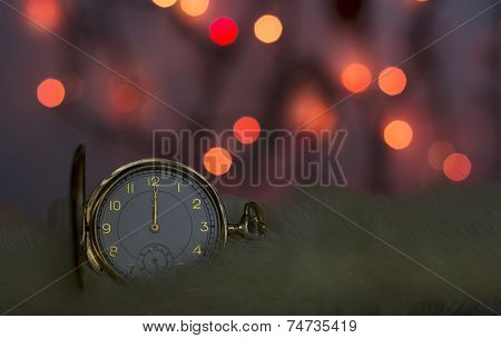 Gold Watch With Red Bokeh Background