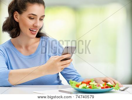 girl taking pictures of fresh salad