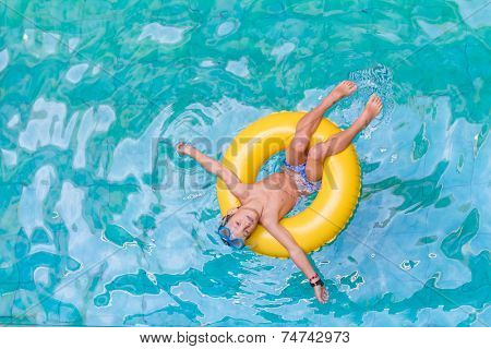 Swimming, summer vacation - lovely child boy playing in blue water (space for text)