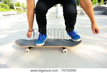 woman skateboarder skateboarding at skate park