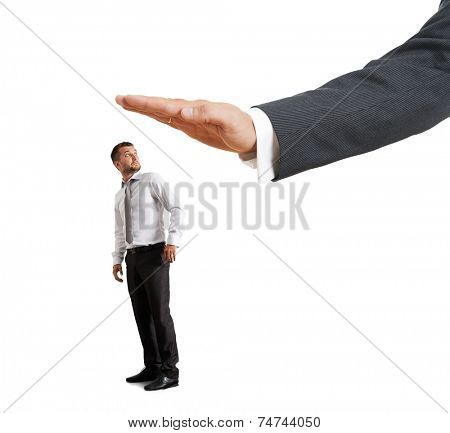 amazed businessman turning around and looking at big palm. isolated on white background