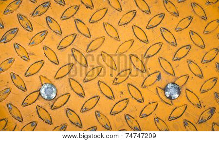 Background of old metal diamond plate in yellow color