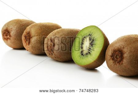 Juicy kiwi in row isolated on white