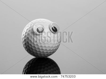 Golf ball with plastic eyes