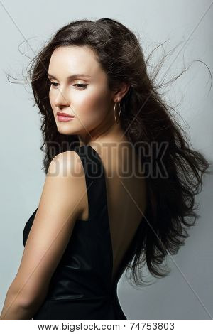Charm. Aristocratic Lady In Black Dress And Flowing Hair