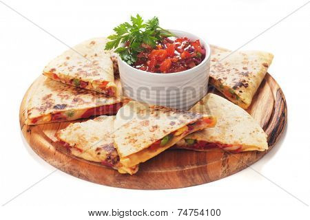 Mexican quesadillas with cheese, vegetables and salsa isolated on white