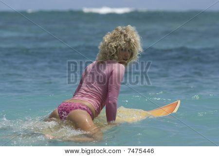 Surfgirl in pink bikini