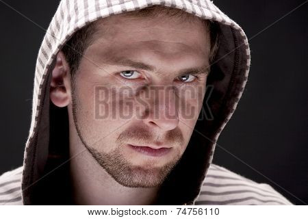 Portrait of young man with a hood