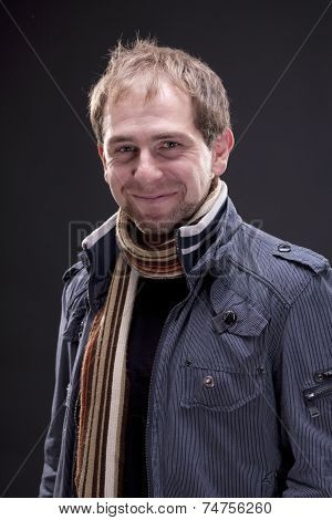 Portrait of a man with jacket and scarf