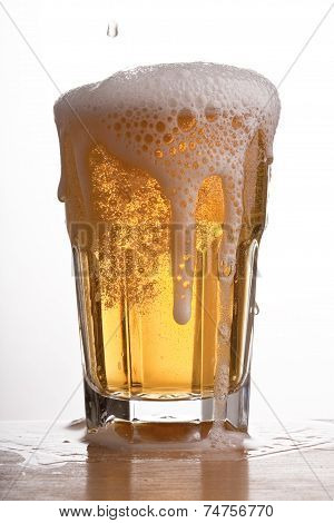 Glass of brimming beer
