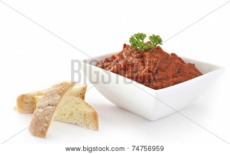 Delicious Bulgarian chutney in dish with a bread