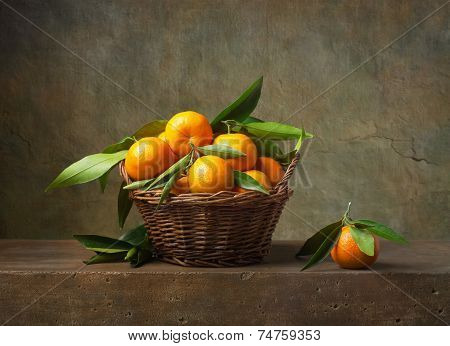 Still life with tangerines in a basket on the table
