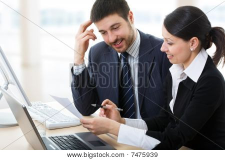 Businessman And Businesswoman Working.
