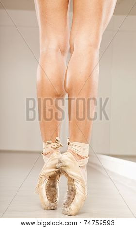 Beautiful woman ballerina legs with pink tiptoe