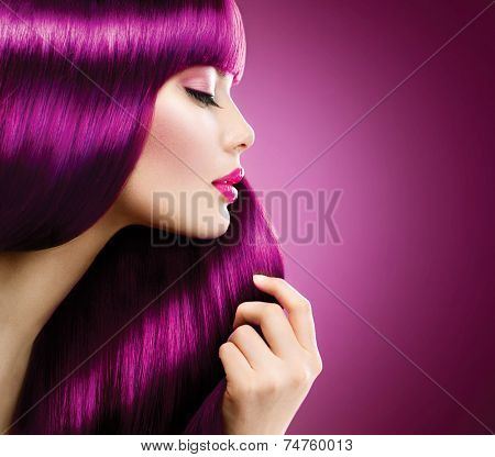 Beauty Model girl with Healthy Purple coloured Hair. Beautiful woman takes her  long smooth pink shiny straight hair. Hairstyle. Hair cosmetics, haircare
