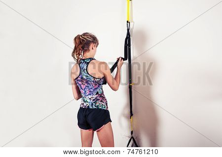 Fit Woman Studying Resistance Band