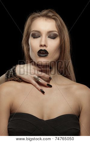Gothic woman with hand of vampire on her neck
