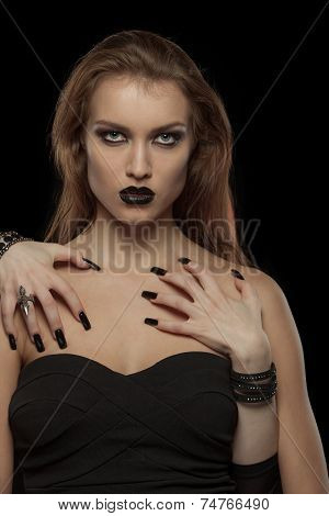 Gothic woman with hands of vampire on her body. Halloween
