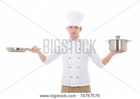 Young Man In Chef Uniform Holding Saucepan And Frying Pan Isolated On White