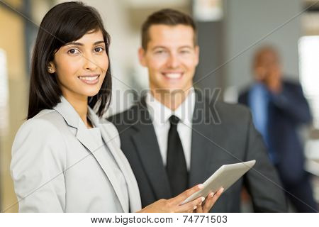beautiful young indian businesswoman with co-worker