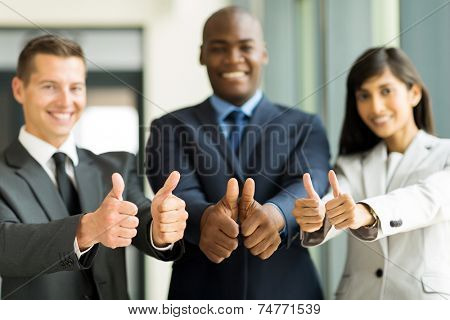 group of successful multiracial business team giving thumbs up