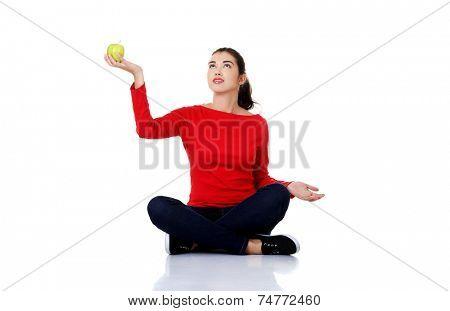 Young beautiful woman sitting cross-legged