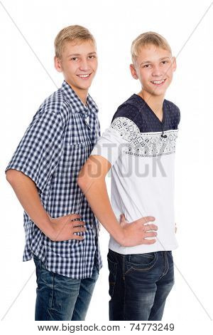 Young boys twin brothers standing isolated on white background
