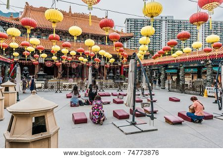 Kowloon, Hong Kong, China - May 30, 2014: people praying at Sik Sik Yuen Wong Tai Sin Temple
