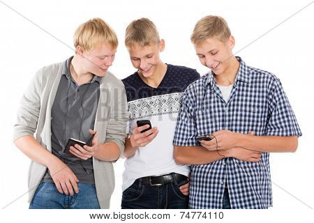 Joyful guys with smartphones isolated on white background. Two of the boys twin brothers.