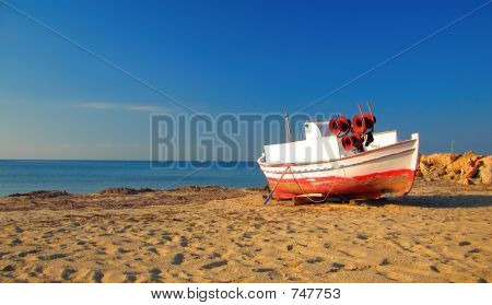 Abandoned ship at the beach in the morning