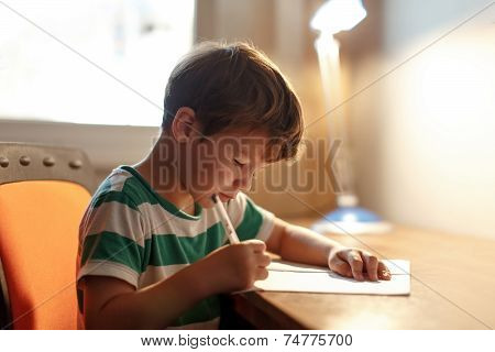 Little Boy Write To Blank Paper