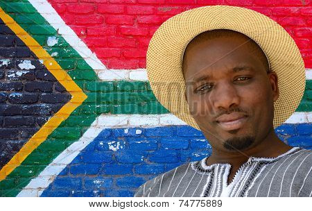 Black man on South African flag background