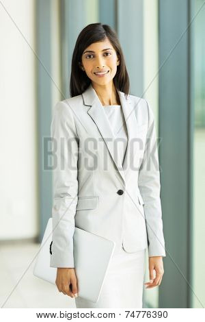 portrait of beautiful young indian career woman holding laptop