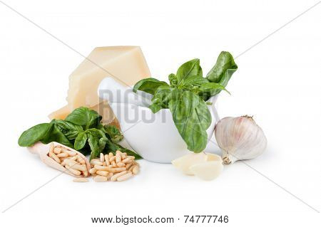 Basil pesto sauce and fresh ingredient on a white background