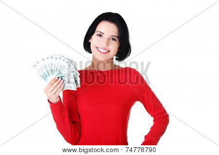 Young smiling woman holding polish money