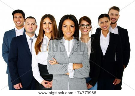 Smiling woman leading her happy team over white background