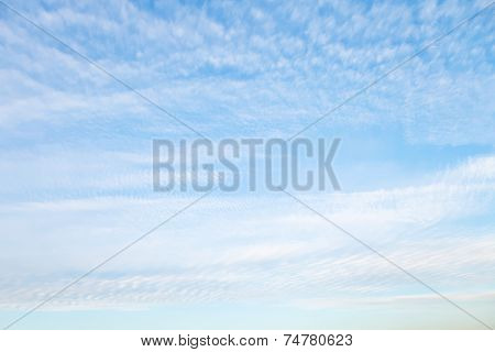 White Cirrus Clouds In Blue Sky