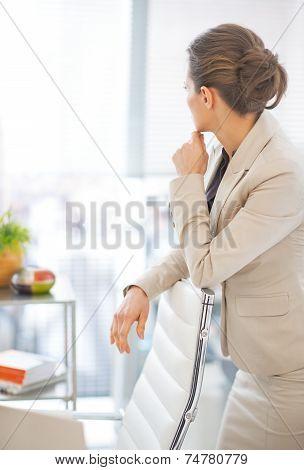 Portrait Of Thoughtful Business Woman Looking In Window