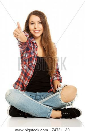 Happy woman sitting cross legged
