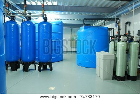 Industry Pipes, Taps, Pump And Blue Barrel