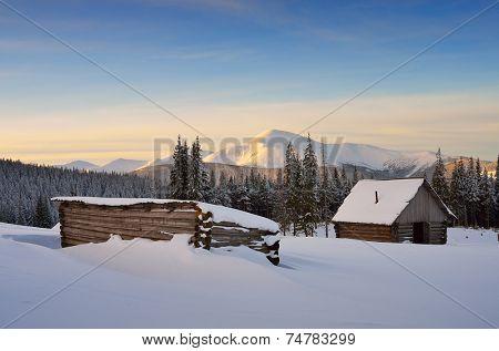 Winter landscape with hut. Sunrise in the mountains. Carpathians, Ukraine, Europe