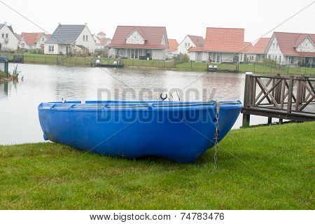 Blue Rowboat On The Lake On Vacation