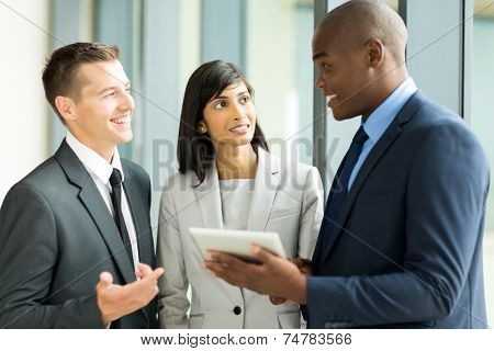 successful multiracial businesspeople working on tablet pc