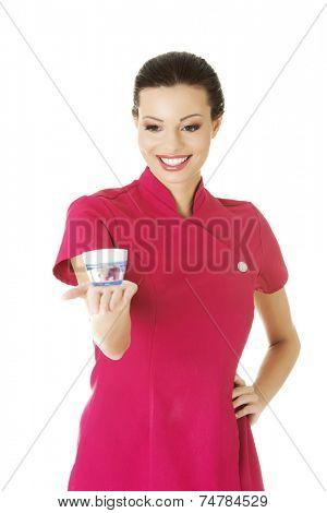 Happy visage artist holding cream container