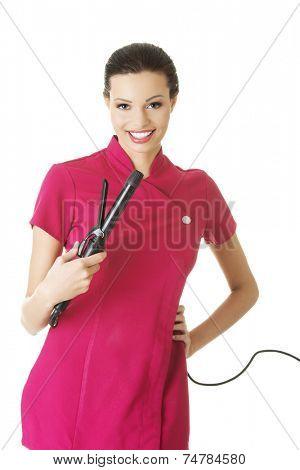 Happy visage artist holding brushes