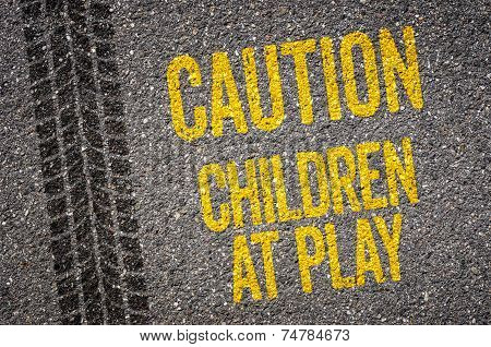 Lane with the text Caution Children at play