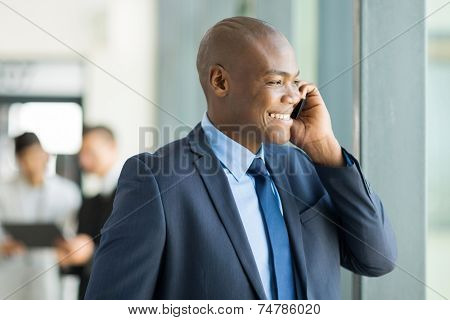 handsome african american business executive talking on cell phone