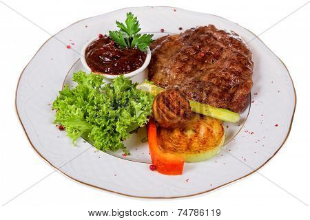 Grilled meat with vegetable on white plate