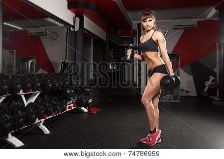 Fitness Young Sexy Girl In The Gym