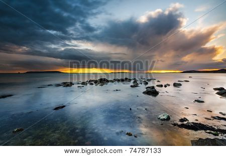 Sunset Under Storm Clouds On The Dorset Coast
